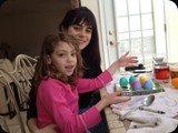 Gia and Jade coloring eggs